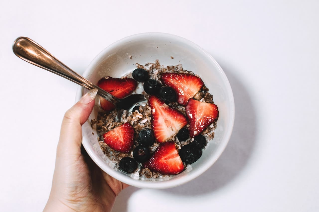 Cereals with strawberries for childrens breakfasts